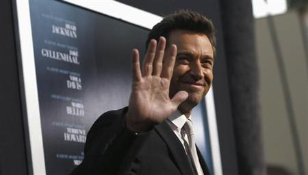 """Cast member Jackman waves at the premiere of his film """"Prisoners"""" at the Academy of Motion Picture Arts and Sciences in Beverly Hills"""