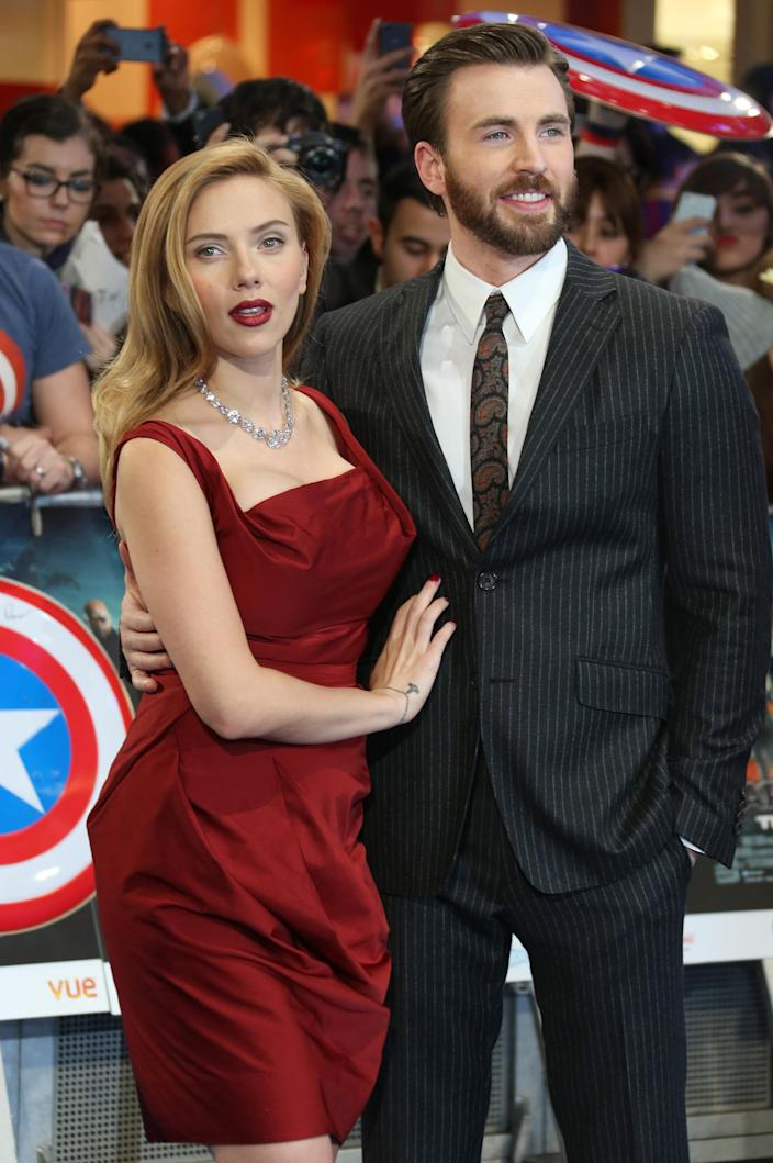 U.S. actors Scarlett Johansson and Chris Evans arrive at the UK premiere of the movie Captain America: The Winter Soldier at the Vue Westfield on Thursday, March 20, 2014 in London. (Photo by Joel Ryan/Invision/AP Images)