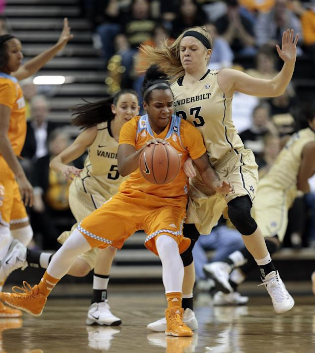 Tennessee guard Ariel Massengale, center, dribbles against Vanderbilt guard Kylee Smith (23) in the first half of an NCAA college basketball game on Sunday, Jan. 12, 2014, in Nashville, Tenn. (AP Photo/Mark Humphrey)