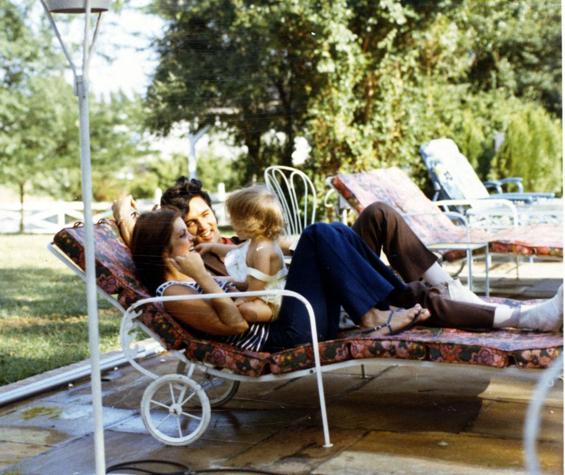 <p>America quickly became obsessed with the beautiful family, pictured here at home at Graceland. (Photo: Magma Agency/WireImage) </p>