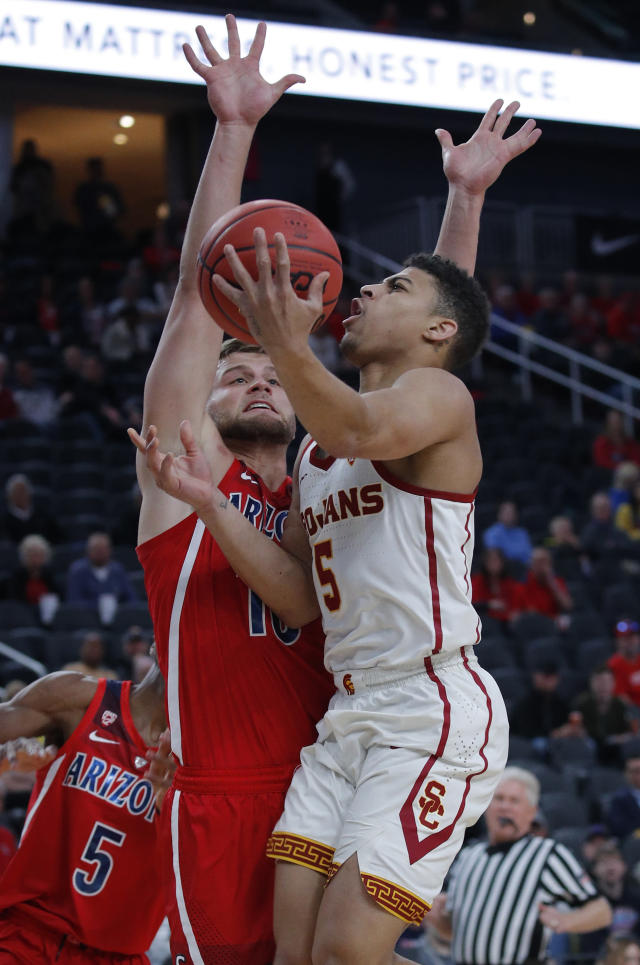 Southern California's Derryck Thornton, right, shoots against Arizona's Ryan Luther during the first half of an NCAA college basketball game in the first round of the Pac-12 conference tournament Wednesday, March 13, 2019, in Las Vegas. (AP Photo/John Locher)