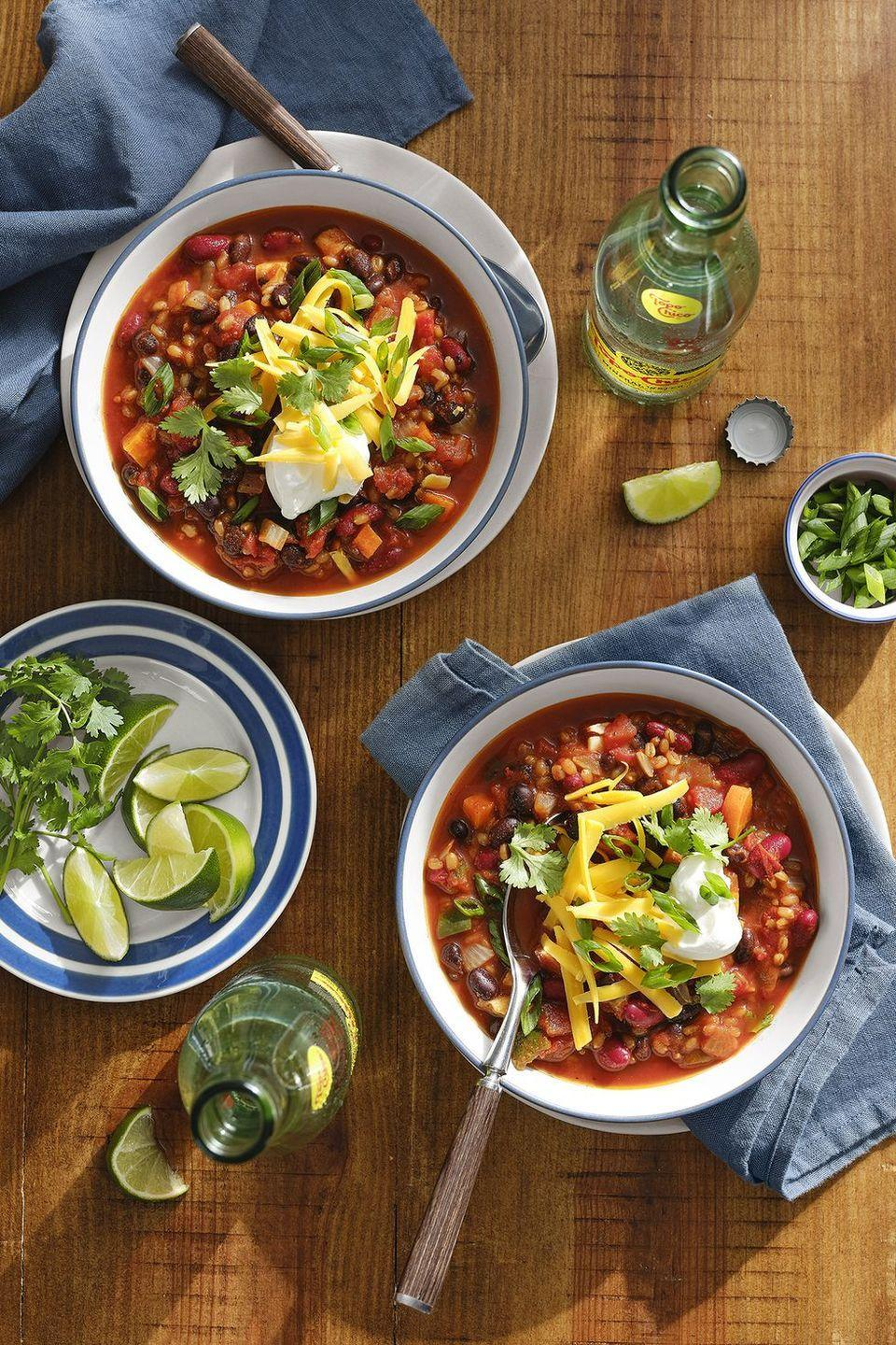 "The secret ingredient that keeps this classic dish every bit as meaty and filling as it's beefier brethren? Wheat berries, which you can pick up in the grain section of most grocery stores. <a href=""https://www.countryliving.com/food-drinks/a30417636/vegetarian-chili-with-grains-beans-recipe/"" rel=""nofollow noopener"" target=""_blank"" data-ylk=""slk:Get the recipe"" class=""link rapid-noclick-resp""><strong>Get the recipe</strong></a><strong>.</strong> <a href=""https://www.amazon.com/Berries-Non-GMO-Verified-Non-Irradiated-Certified/dp/B004LYXHKG/?tag=syn-yahoo-20&ascsubtag=%5Bartid%7C10050.g.1186%5Bsrc%7Cyahoo-us"" class=""link rapid-noclick-resp"" rel=""nofollow noopener"" target=""_blank"" data-ylk=""slk:SHOP WHEAT BERRIES""><strong>SHOP WHEAT BERRIES</strong></a>"