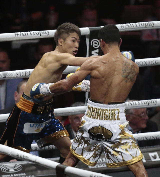 Naoye Inoue , left, of Japan, fights Emmanuel Inoue, of Puerto Rico in an IBF world bantamweight boxing match at The SSE Hydro, Saturday, May 18, 2019, in Glasgow, Scotland. (Graham Stuart/PA via AP)