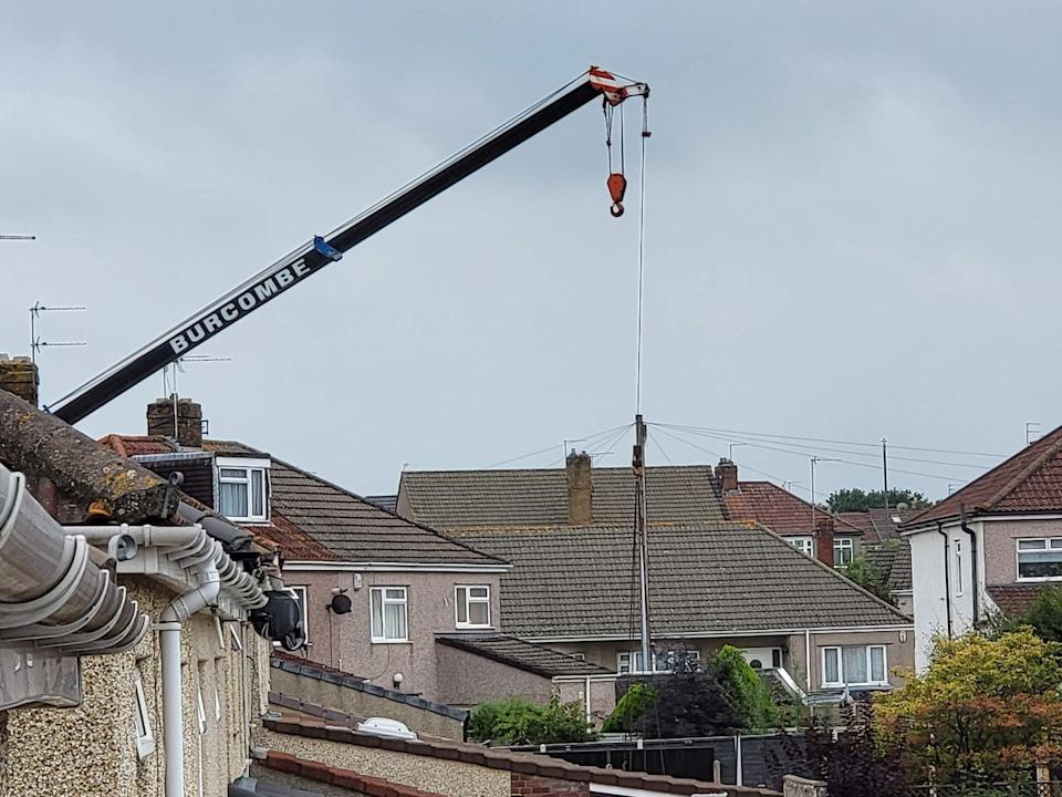 A man in his 70s has died after a heavy load fell from a crane in the Mangotsfield area of Bristol. (BPM Media)