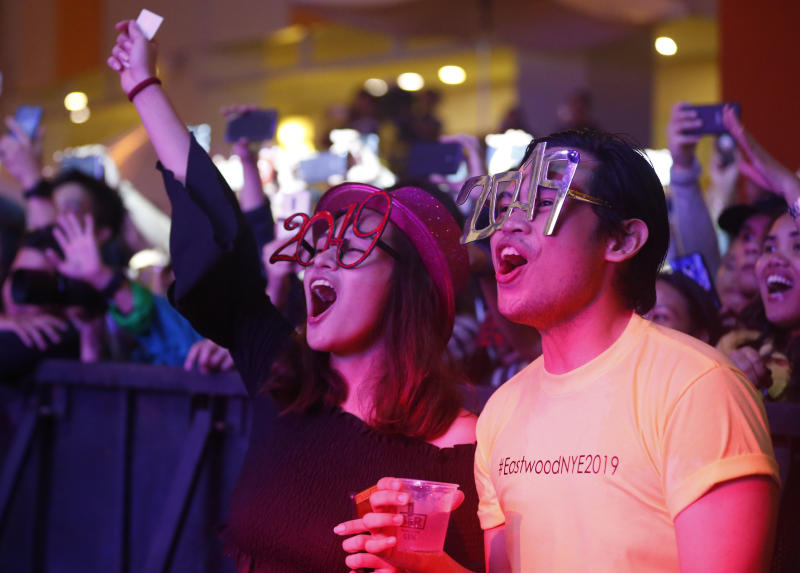 Filipinos cheer during a New Year countdown at the Eastwood Shopping Mall late Monday, Dec. 31, 2018 in suburban Quezon city northeast of Manila, Philippines. Filipinos welcome the New Year with the loudest noise possible including setting off powerful firecrackers in one of Asia's most violent celebrations