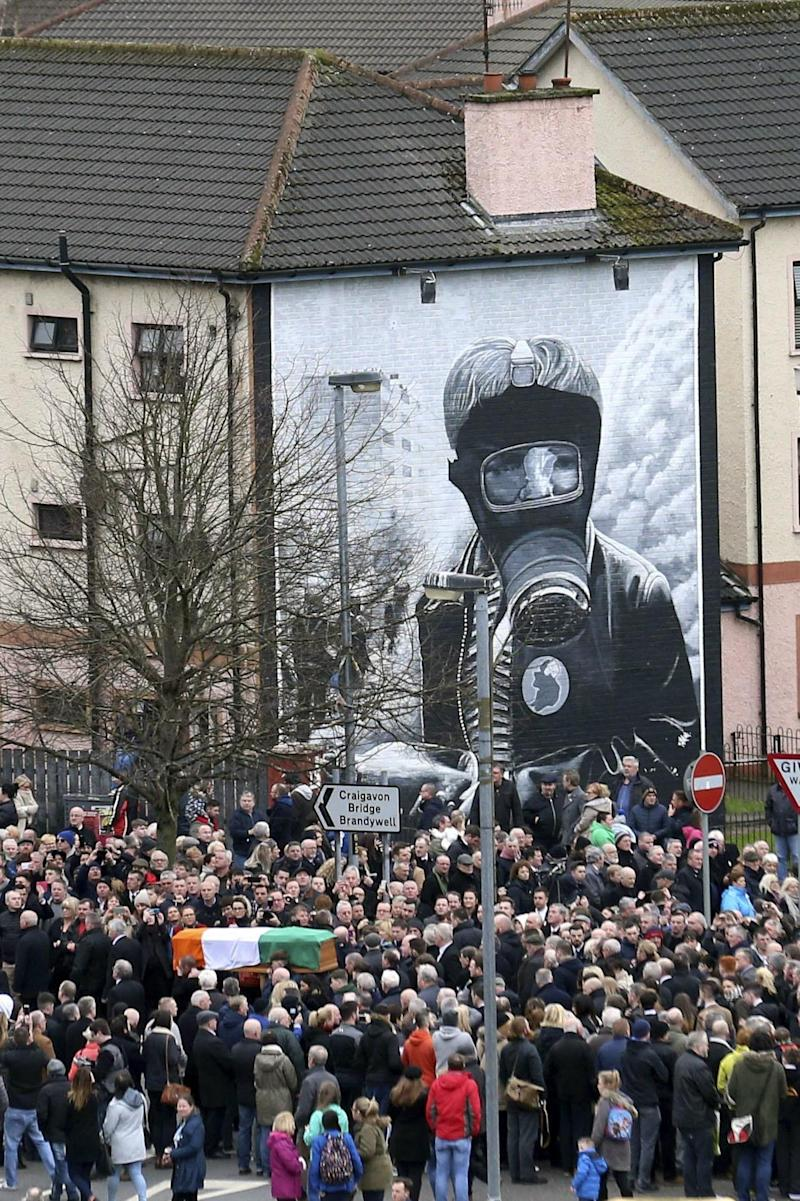 Bogside: The coffin was carried through the town as crowds applauded (AP)