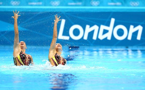 LONDON, ENGLAND - AUGUST 05:  Nadine Brandl and Livia Lang of Austria compete in the Women's Duets Synchronised Swimming Technical Routine on Day 9 of the London 2012 Olympic Games at the Aquatics Centre  on August 5, 2012 in London, England.  (Photo by Al Bello/Getty Images)