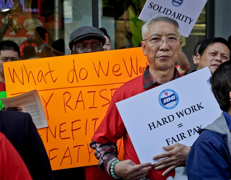 """Striking independent drivers rally outside ride-hailing giants Uber and Lyft offices, calling for """"fair pay for all drivers,"""" Wednesday May 8, 2019, in New York. (AP Photo/Bebeto Matthews)"""