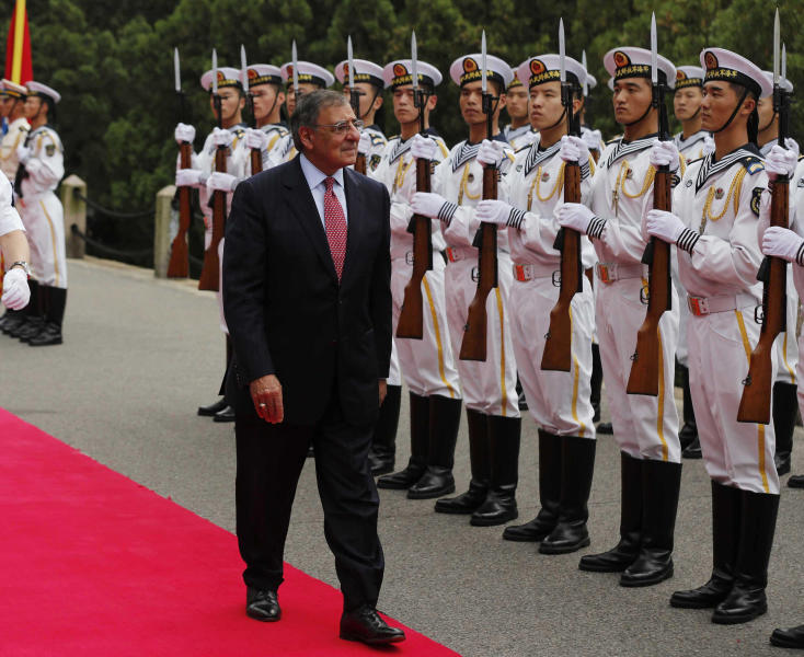 U.S. Defense Secretary Leon Panetta reviews a naval honor guard at Qingdao, China before touring Chinese naval vessels of the North Sea Fleet Thursday, Sept. 20, 2012. (AP Photo/Larry Downing, Pool)