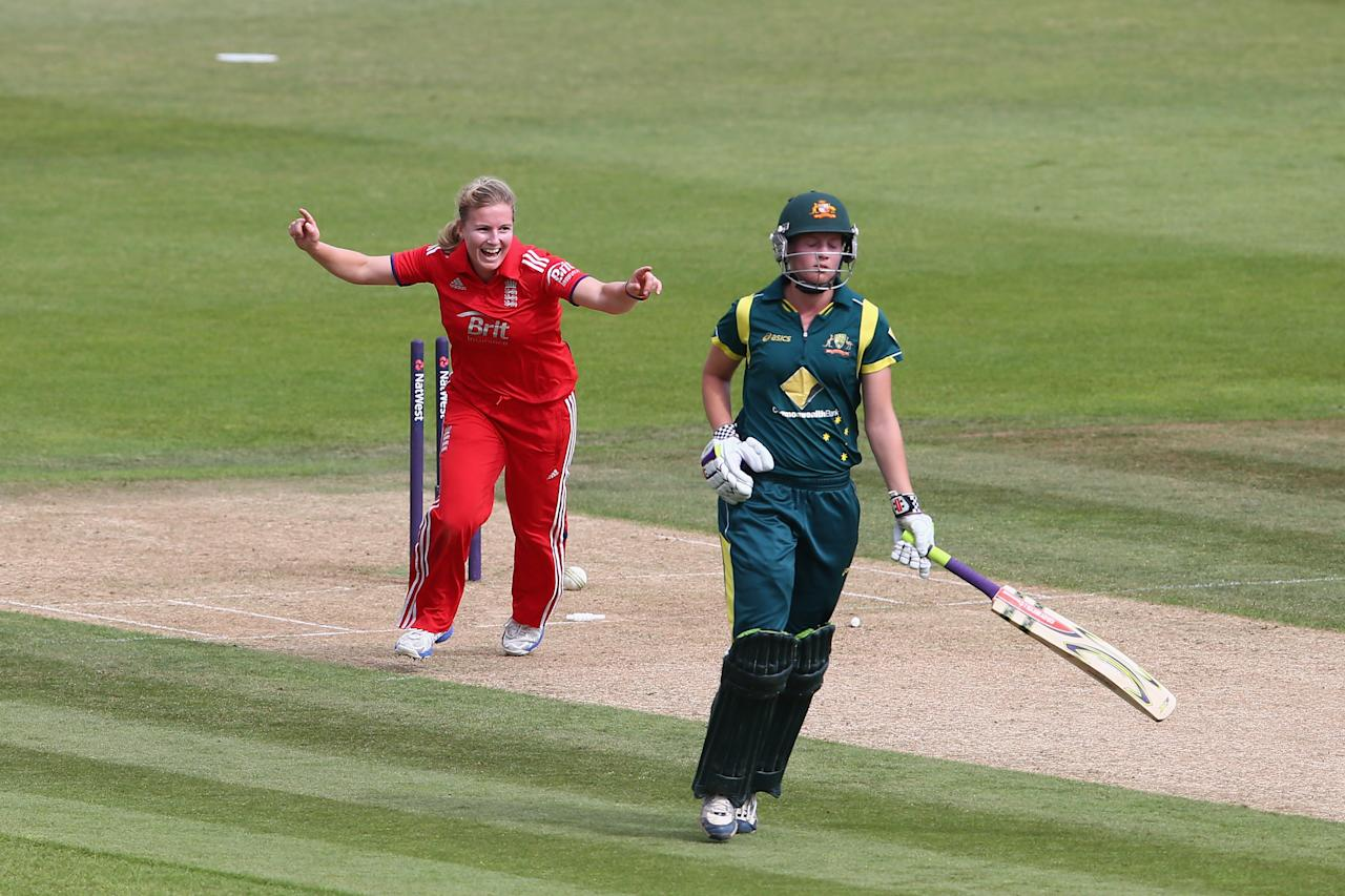 SOUTHAMPTON, ENGLAND - AUGUST 29:  Holly Colvin of England celebrates running out Meg Lanning of Australia for 60 runs during the 2nd England NatWest T20 match between England Women and Australia Women at Ageas Bowl on August 29, 2013 in Southampton, England.  (Photo by Paul Gilham/Getty Images)
