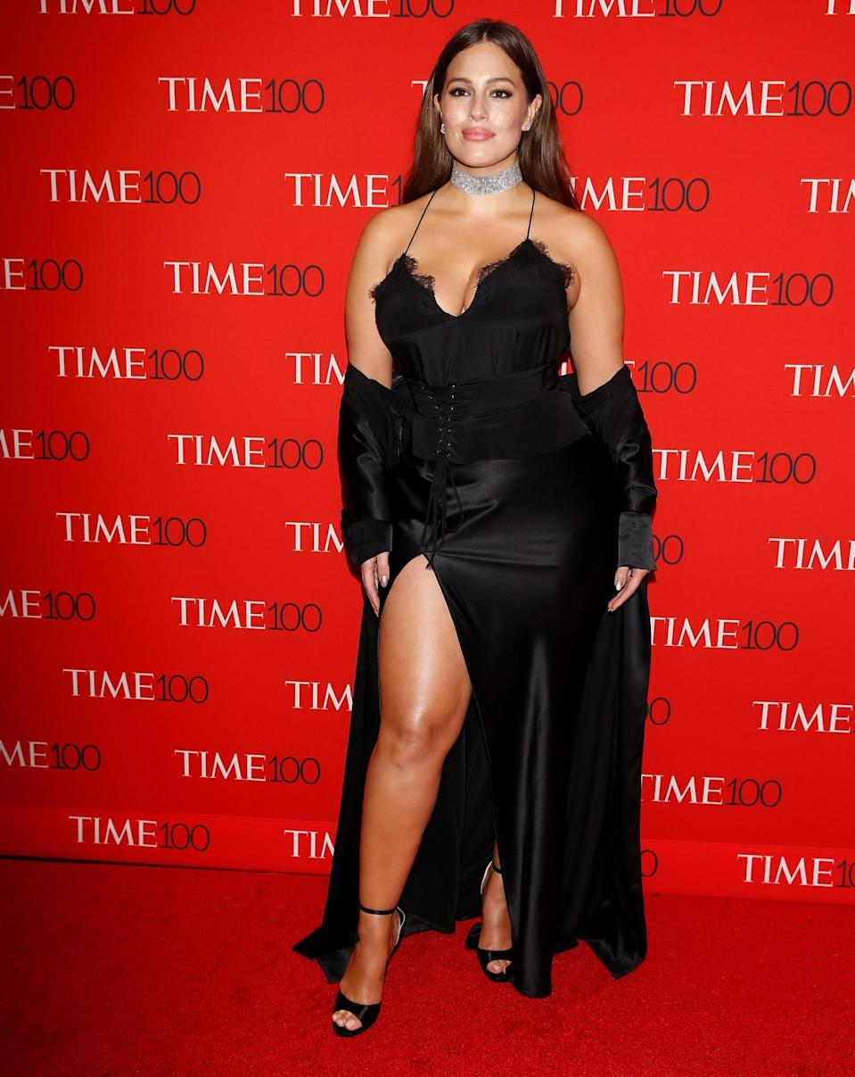 <p>The model ensured all eyes were on her in a corseted lingerie-style dress and diamond choker. (Photo: Reuters) </p>