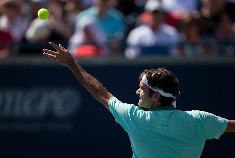 Roger Federer of Switzerland serves to Jo-Wilfried Tsonga of France in the final of the Rogers Cup at Rexall Centre in Toronto, Ontario, August 10, 2014. Tsonga defeated Federer 7-5, 7-6