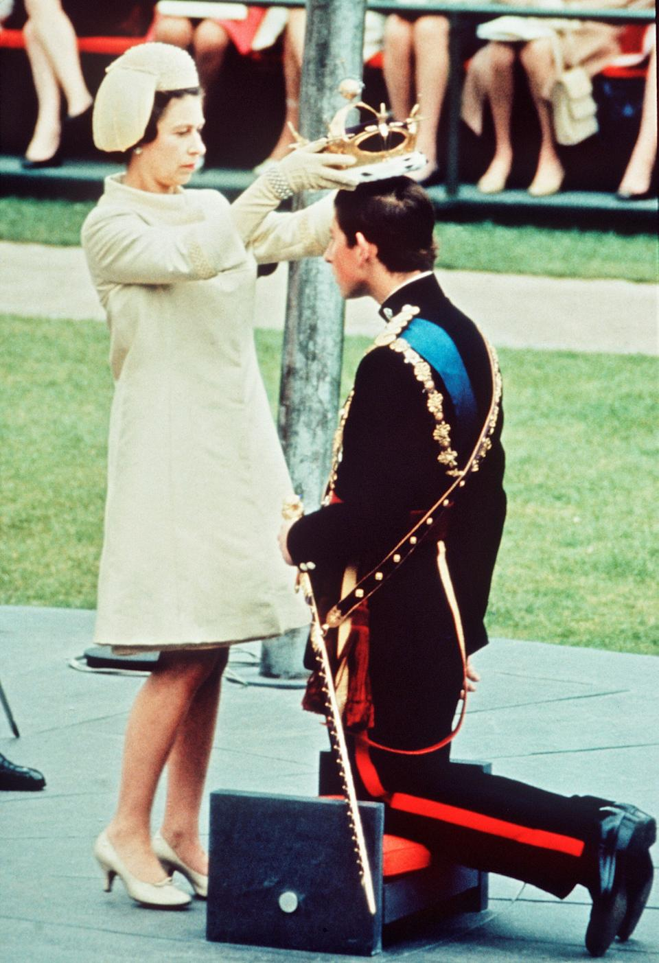 The Investiture of The Prince of Wales at Caernarvon Castle on July 1,1969. Prince Charles kneels before Queen Elizabeth as she places the coronet on his head.
