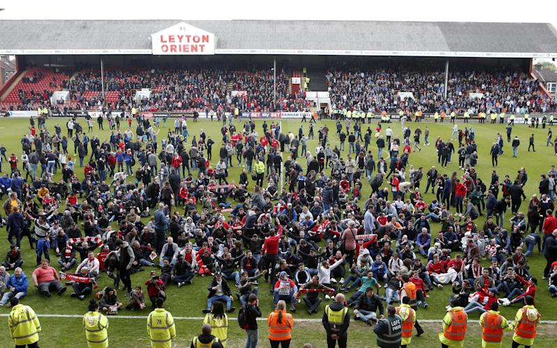 Leyton Orient fans stage a sit-down protest at Brisbane Road  - REX