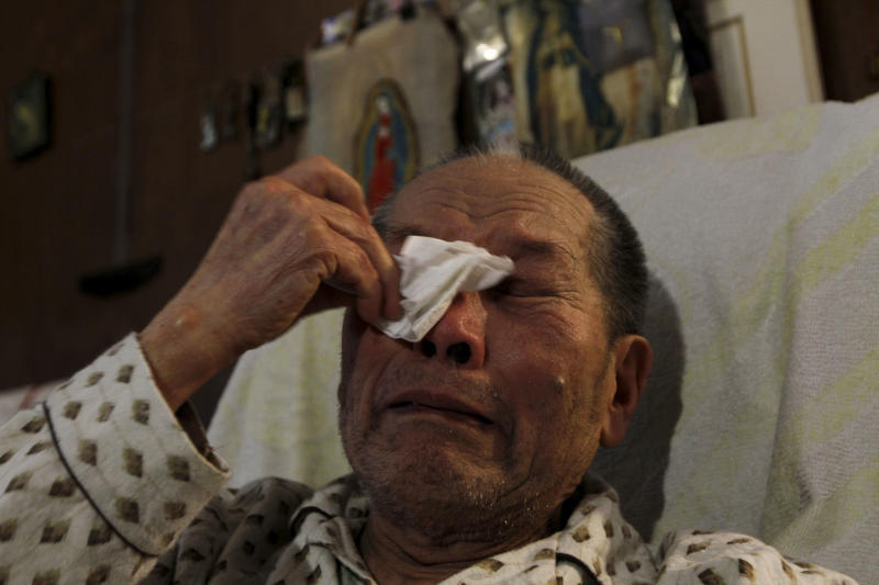 In this photo taken Saturday, Nov. 17, 2012, Juan Chiu Trujillo, a Chinese Mexican weeps as he recounts his life story during an interview in Mexico City. Chiu who was born in Mexico, was among thousands of Chinese Mexicans expelled when Mexico erupted into xenophobia fueled by the economic turmoil of the Great Depression. Chiu returned in 1960, along with 300 other Chinese-Mexicans, after President Adolfo Lopez Mateos paid for their travel expenses and decreed that they would be legally allowed to live in Mexico. Dozens of those Chinese-Mexicans and their descendants gather Saturday, Nov. 24, 2012, at a Chinese restaurant in central Mexico City to celebrate the anniversary of their return. (AP Photo/Marco Ugarte)