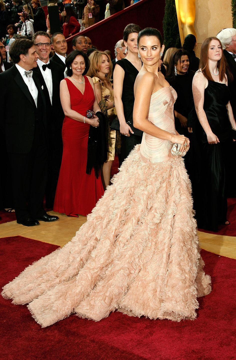 <p>The actress brought major volume to the red carpet in a blush pink Versace gown with a ruffled train and tight-fitting bodice. She finished off the look with a sleek bun, statement stud earrings, and a small clutch. </p>