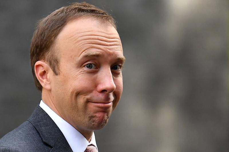 Health secretary Matt Hancock reacts as he leaves from 10 Downing Street in central London on Wednesday (Photo: DANIEL LEAL-OLIVAS via Getty Images)