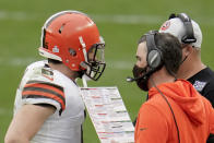 Cleveland Browns quarterback Baker Mayfield (6) talks with head coach Kevin Stefanski during the second half of an NFL football game, Sunday, Oct. 18, 2020, in Pittsburgh. The most recognizable trend in hiring NFL head coaches has been to target young, innovative offensive teachers with a track record of developing quarterbacks. (AP Photo/Gene J. Puskar)