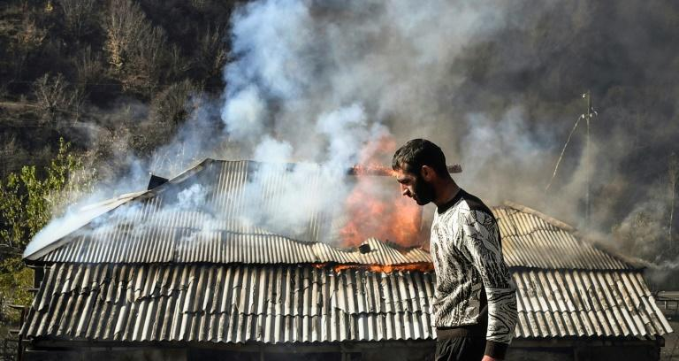 Some residents of the Charektar village have set their homes on fire before Azerbaijan reclaims the area