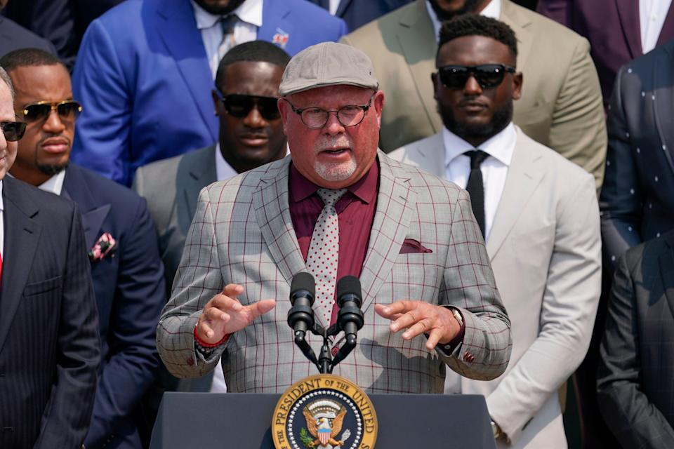 Tampa Bay Buccaneers head coach Bruce Arians, surrounded by members of the Tampa Bay Buccaneers, speaks during a ceremony on the South Lawn of the White House, in Washington, Tuesday, July 20, 2021, where President Joe Biden honored the Super Bowl Champion Tampa Bay Buccaneers for their Super Bowl LV victory. (AP Photo/Andrew Harnik)