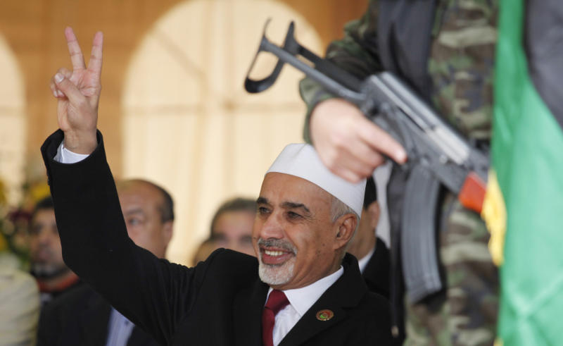 Libyan interim president, Mohammed el-Megarif, flashes the victory sign to crowds during the celebration of the second anniversary of the Libyan revolution in Benghazi, Libya, Sunday, Feb, 17, 2013. Addressing thousands of flag-waving Libyans, El-Megarif called on Sunday for unity in the North African nation as it celebrates the second anniversary of the uprising that toppled longtime dictator Moammar Gadhafi but plunged the country into lawlessness and economic woes. (AP Photo/Mohammad Hannon)