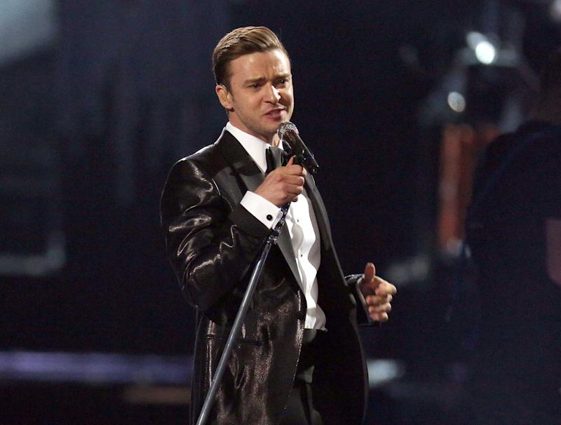 """FILE - This Feb. 20, 2013 file photo shows Justin Timberlake during the BRIT Awards 2013 in London.  The final numbers aren't in yet, but last weekend's """"Saturday Night Live"""" with Justin Timberlake as host had far more viewers than anything NBC aired in prime time last week. The badly slumping NBC had its lowest prime-time viewership average ever, even counting summer months, the Nielsen company said. (Photo by Joel Ryan/Invision/AP, file)"""