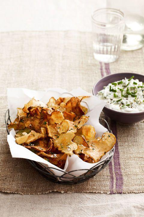 "<p>This seasonal take on chips and dip is full of deep, rich flavors and perfect for a Super Bowl bash.</p><p><span class=""redactor-invisible-space""><em><a href=""http://www.countryliving.com/food-drinks/recipes/a4851/sunchoke-chips-warm-blue-cheese-dip-recipe-clv0214/"" rel=""nofollow noopener"" target=""_blank"" data-ylk=""slk:Get the recipe from Country Living »"" class=""link rapid-noclick-resp"">Get the recipe from Country Living »</a></em></span></p>"