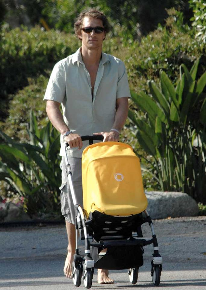 """A barefoot Matthew McConaughey was spotted pushing his son Levi's stroller on Saturday. Matthew was reportedly paid $3 million by OK! Magazine for exclusive baby pics -- a offer usually reserved for A-list actresses. A. Macpherson/<a href=""""http://www.splashnewsonline.com"""" target=""""new"""">Splash News</a> - July 25, 2008"""