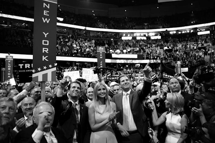 <p>Donald Trump's children, (L to R) Donald Jr, Ivanka, Eric and Tiffiny celebrate as Donald Jr. announces the delegate count putting their father over the top to clinch the nomination during the RNC Convention in Cleveland, OH on July 19, 2016. (Photo: Khue Bui for Yahoo News)</p>