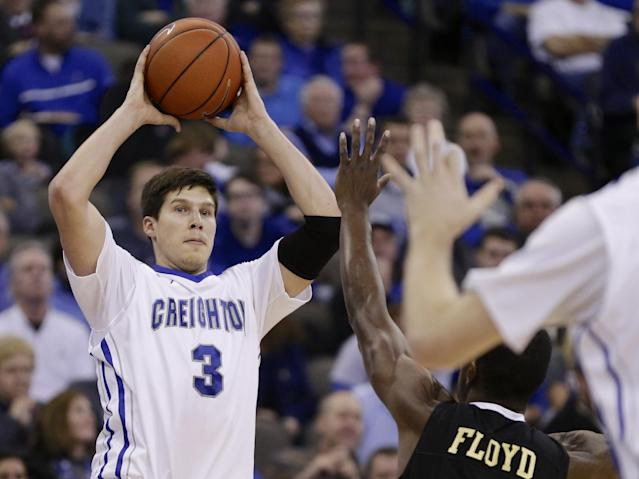 Creighton's Doug McDermott (3) looks for an open player as he is defended by Arkansas-Pine Bluff's Jaylon Floyd in the second half of an NCAA college basketball game in Omaha, Neb., Tuesday, Dec. 17, 2013. Creighton won 88-51. (AP Photo/Nati Harnik)