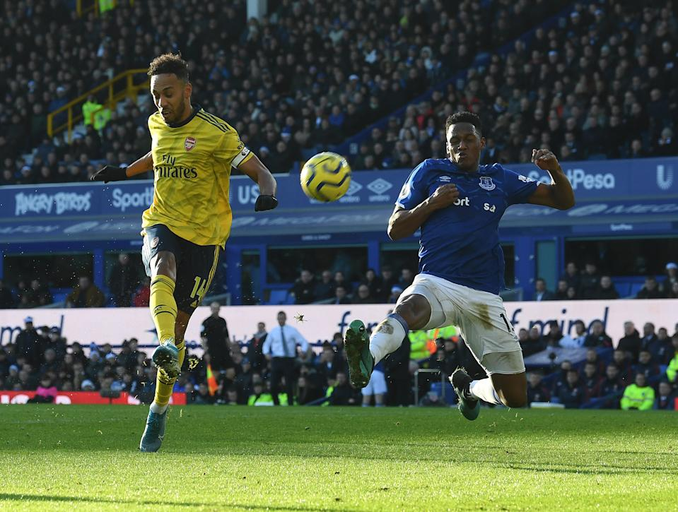 LIVERPOOL, ENGLAND - DECEMBER 21: Pierre-Emerick Aubameyang of Arsenal challenged Yerry Mina of Everton during the Premier League match between Everton FC and Arsenal FC at Goodison Park on December 21, 2019 in Liverpool, United Kingdom. (Photo by Stuart MacFarlane/Arsenal FC via Getty Images)