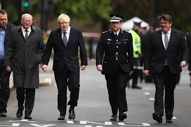 LONDON, ENGLAND - MAY 23: Mayor of London Boris Johnson arrives to speak to the media close to a crime scene where a Soldier from Wellington Barracks was killed yesterday, on May 23, 2013 in London, England. A British soldier was murdered by suspected Islamists near London's Woolwich Army Barracks yesterday in a savage knife attack. British Prime Minister David Cameron has said that the 'appalling' attack appeared to be terror related. (Photo by Dan Kitwood/Getty Images)