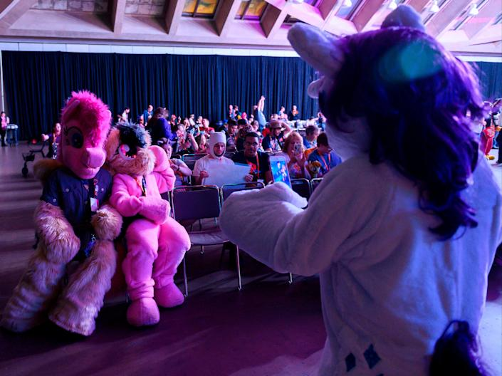 """Fans are dressed as """"My Little Pony"""" characters during the BronyCon convention, in Baltimore, Maryland on August 1, 2019. (AFP via Getty Images)"""