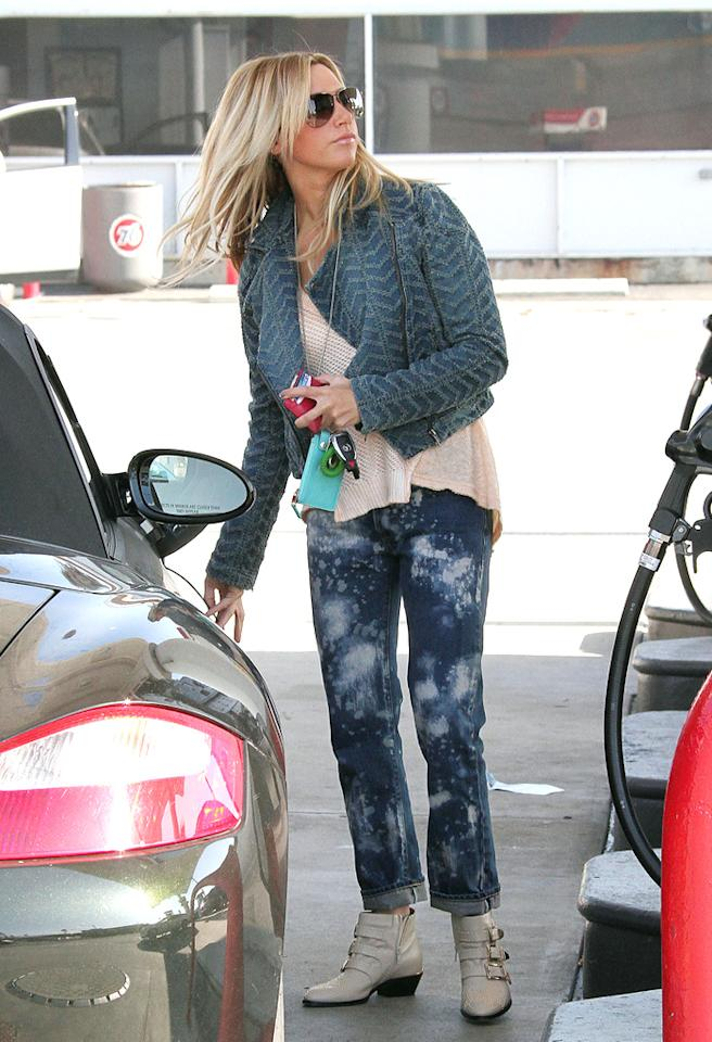 88063, LOS ANGELES, CALIFORNIA - Friday December 7, 2012.  Actress Ashley Tisdale fills up at the gas station in Los Angeles while chatting on her phone. Photograph: © Bunny, PacificCoastNews.com   **FEE MUST BE AGREED PRIOR TO USAGE** **E-TABLET/IPAD & MOBILE PHONE APP PUBLISHING REQUIRES ADDITIONAL FEES** LOS ANGELES OFFICE:  1 310 822 0419 LONDON OFFICE:  44 20 8090 4079