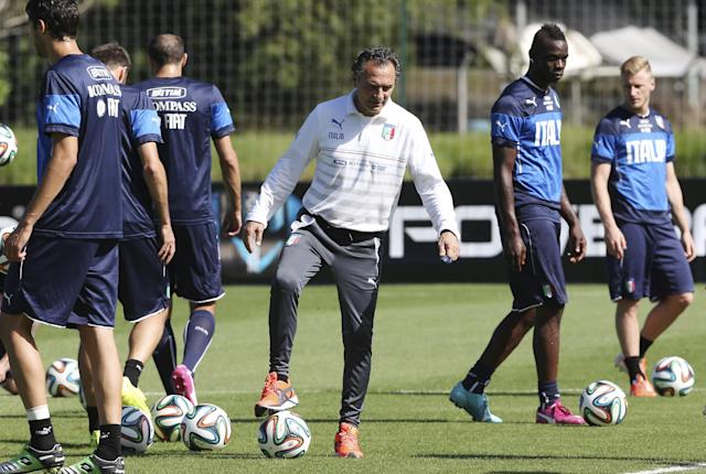 Italy's coach Cesare Prandelli, center, leads his team's training session in Mangaratiba, Brazil, Thursday, June 12, 2014. Italy plays in group D at the World Cup. (AP Photo/Antonio Calanni)