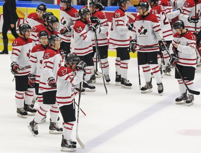 Canada reacts after their loss to Russia following their IIHF World Junior Championship bronze medal ice hockey game in Malmo, Sweden, January 5, 2014. REUTERS/Alexander Demianchuk (SWEDEN - Tags: SPORT ICE HOCKEY)