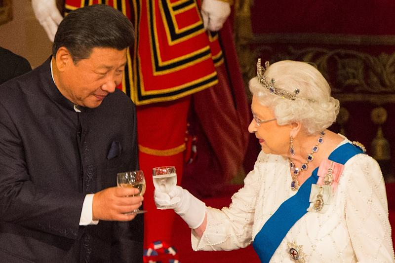 The Queen shares a toast with President of China Xi Jinping in October last year: Getty