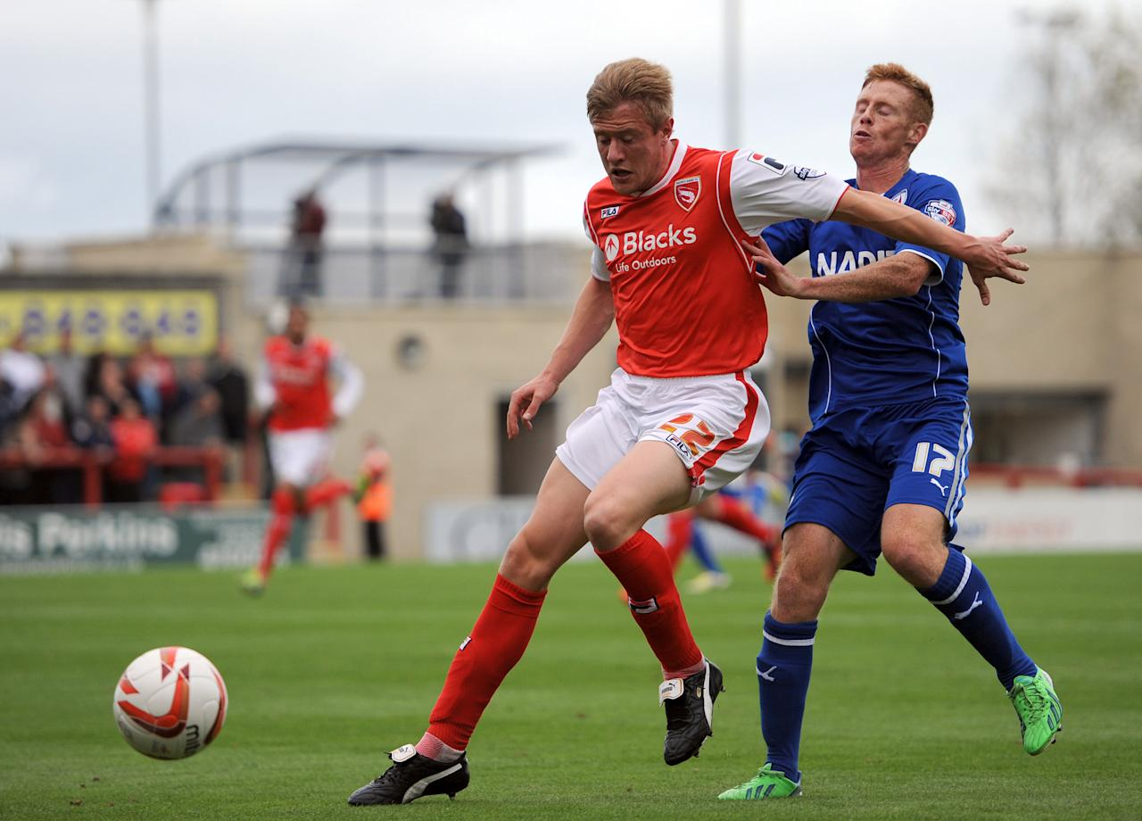 Morecambe's Andy Parrish (Left) and Chesterfield's Eoin Doyle battle for the ball during the Sky Bet League Two match at Globe Arena, Morecambe.