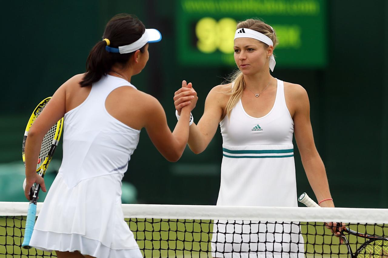 LONDON, ENGLAND - JULY 02:  Maria Kirilenko of Russiain is congratulated by Shuai Peng of China after her Ladies' singles fourth round match on day seven of the Wimbledon Lawn Tennis Championships at the All England Lawn Tennis and Croquet Club on July 2, 2012 in London, England.  (Photo by Julian Finney/Getty Images)