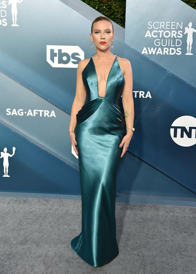 Looking simply stunning, Scarlett Johansson wore a satin teal dress by Armani with a plunging V-neckline. [Photo: Getty]