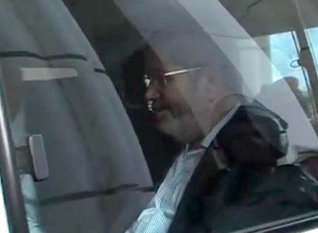 """This image made from video provided by Egypt's Interior Ministry shows ousted President Mohammed Morsi inside a vehicle as he arrives at a police academy for a trial hearing in Cairo, Egypt, Monday, Nov. 3, 2013. Emerging from four months in secret detention, Egypt's deposed Islamist president defiantly rejected a court's authority to try him Monday, saying he was the country's """"legitimate"""" leader and those that overthrew him should face charges instead.(AP Photo/Egyptian Interior Ministry)"""