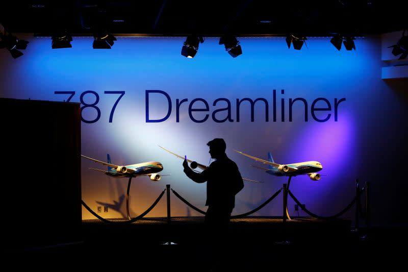A journalist records a video before a delivery ceremony of the new Boeing 787-10 Dreamliner at Boeing South Carolina in North Charleston