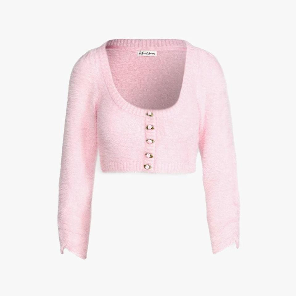 """Rose-shaped buttons give this shrunken knit a romantic update. $92, REVOLVE. <a href=""""https://www.revolve.com/for-love-lemons-anastasia-cropped-cardigan-in-carnation/dp/FORL-WK79/"""" rel=""""nofollow noopener"""" target=""""_blank"""" data-ylk=""""slk:Get it now!"""" class=""""link rapid-noclick-resp"""">Get it now!</a>"""