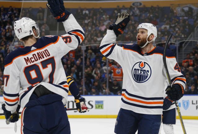 Edmonton Oilers forwards Connor McDavid (97) and Zack Kassian (44) celebrate a goal during the second period of an NHL hockey game against the Buffalo Sabres, Monday, March 4, 2019, in Buffalo N.Y. (AP Photo/Jeffrey T. Barnes)
