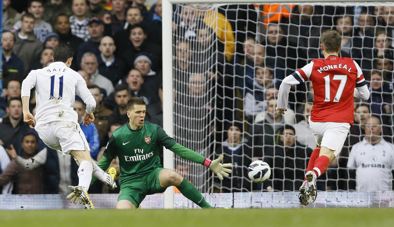 Tottenham Hotspur's Gareth Bale, left, shoots and scores a goal against Arsenal during the English Premier League soccer match between Tottenham and Arsenal at Tottenham's White Hart Lane stadium in London, Sunday, March  3, 2013. (AP Photo/Kirsty Wigglesworth)