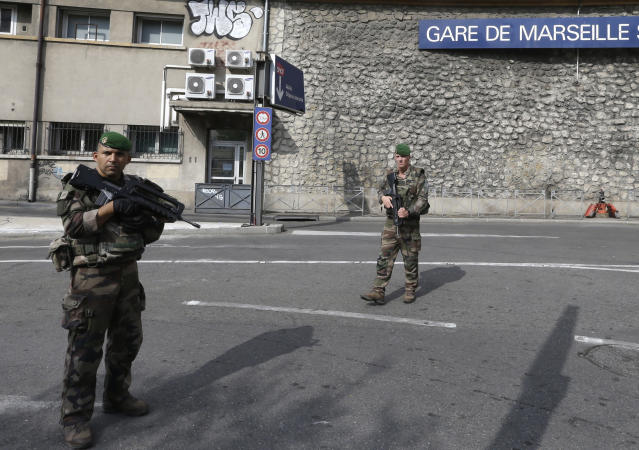 <p>French soldiers patrol outside the Marseille railway station, Oct. 1, 2017. French police warn people to avoid Marseille's main train station amid reports of knife attack, assailant shot dead. (AP Photo/Claude Paris) </p>