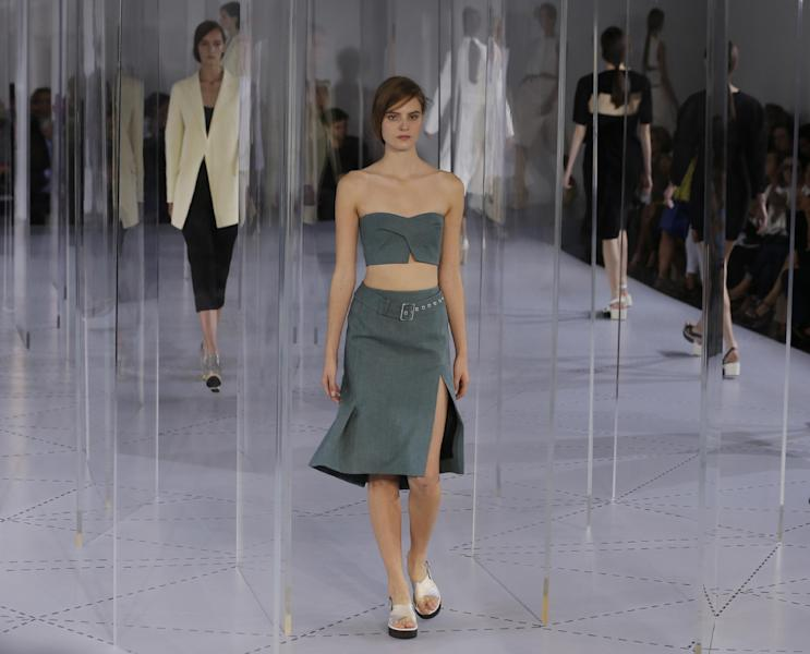 Models wear creation for Jil Sander women's Spring-Summer 2014 collection, part of the Milan Fashion Week, unveiled in Milan, Italy, Saturday, Sept. 21, 2013. (AP Photo/Luca Bruno)
