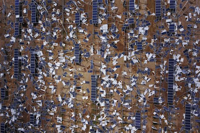 <p>Solar panel debris is seen scattered in a solar panel field in the aftermath of Hurricane Maria in Humacao, Puerto Rico on Oct. 2, 2017. (Photo: Ricardo Arduengo/AFP/Getty Images) </p>
