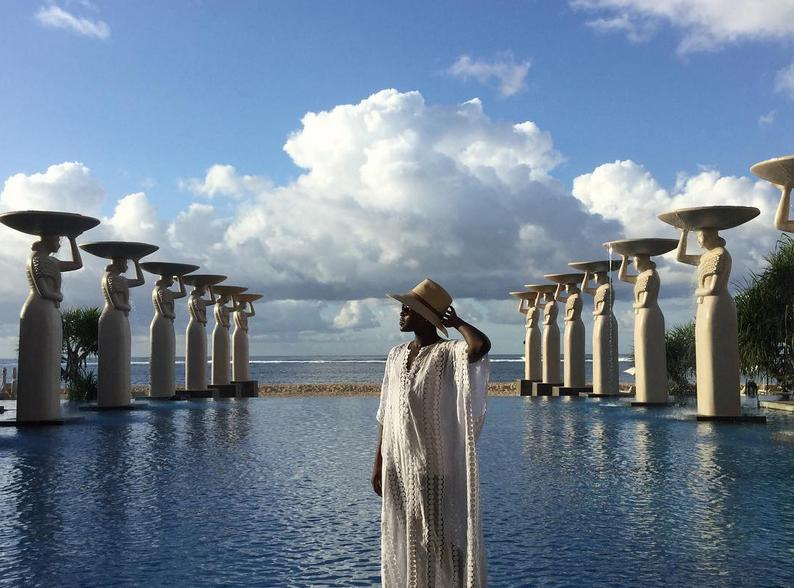 The fashionista's cover-up game is strong (which is important when one is on vacation) as she posed at the Oasis Pool.