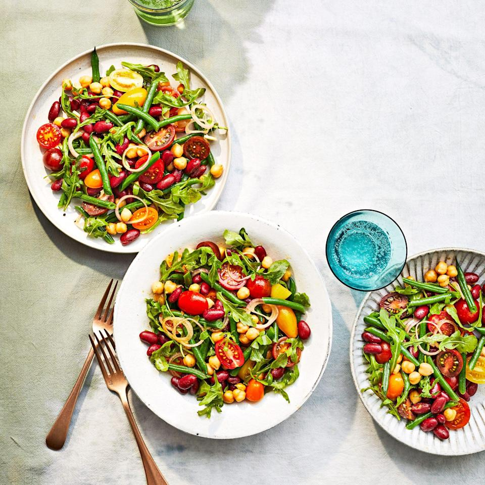 """<p><strong>Recipe: </strong><a href=""""https://www.southernliving.com/recipes/three-bean-salad-tomatoes-tangy-creole-dressing"""" rel=""""nofollow noopener"""" target=""""_blank"""" data-ylk=""""slk:Three-Bean Salad with Tomatoes and Tangy Creole Dressing"""" class=""""link rapid-noclick-resp""""><strong>Three-Bean Salad with Tomatoes and Tangy Creole Dressing</strong></a></p> <p>This summery salad is a great side dish or main with added protein like grilled shrimp, chicken, salmon, or steak.</p>"""